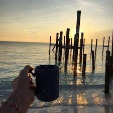 Sunrise beach club and villas 3.5 out of 5.0. Beach Sunrise Morning Coffee Vacation Mug Wild Walk Calm Relax Peaceful Enjoy Explore Carpediem Stock Photo 0863a001 95c9 4249 Ac0c 7f9e5b49ff0d