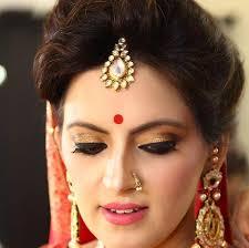 smokey golden bridal eye makeup with bindi traditional indian