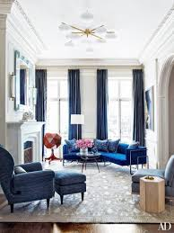 Neo-traditional blue living room with cobalt sectional in New York  townhouse on Thou Swell