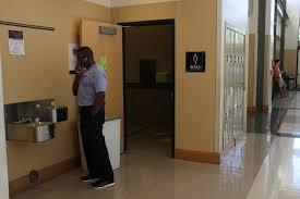 school bathroom door. Custodian+Engineer+Al+Lowe+holds+open+the+door+ School Bathroom Door