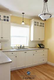 benjamin moore suntan yellow in kitchen with quartz painted cream oak cabinets similar to white