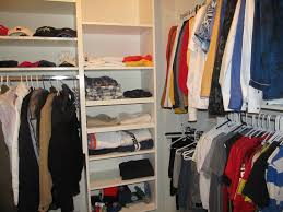 furniture white wooden closet with shelves for saving clothes plus silver steel pole for hanging