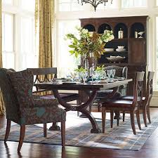 love the accent chairs at the ends of the dining table upholster two chairs in a fabulous fabric woodlands trestle dining by furniture
