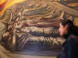 a visitor to the chapultepec castle admires siqueiros