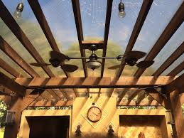 outdoor deck wood restaurant home stone porch ceiling cooking kitchen patio fireplace tile exterior lighting cook
