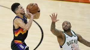 Halfway there: Phoenix Suns beat Bucks ...