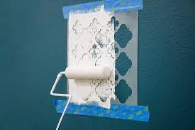 painting with a stencil to create an eye catching accent wall