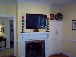 baby nursery winning how to hang a plasma tv over the fireplace steps above height