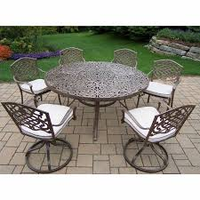 oakland living mississippi dining set with 60 round table cushioned 4 stackable chairs and 2 swivel rockers in antique bronze 7 piece