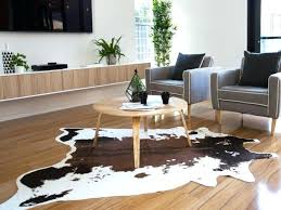 white faux cowhide rug adorable for living room decor idea cow hide and silver