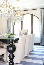 beautiful dining room features a two white beaded chandeliers ro sham beaux fiona white swirl