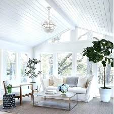 tongue and groove ceiling this family room is pure serenity with its white walls panels boar