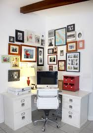 organizing office space. home office with photo wall organizing space