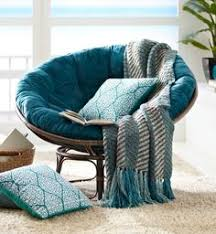 Changing the cushion of the classic Pier 1 Papasan and coordinating with  pillows and throws makes
