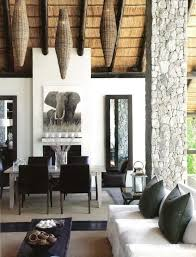 Modern space with traditional African ceiling and woven basket lamps ...