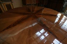 razor thin polished glossy finish catches light and show wood grain