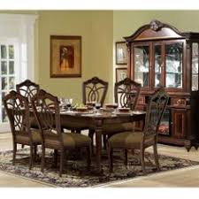 The Castle Dining Group by RiversEdge features crafted in hardwood