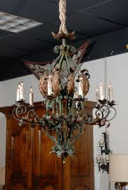 a rococo style green painted iron chandelier with 10 lights and gilt tole acanthus leaf amp