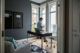 in home office. Man Text Messaging In Home Office