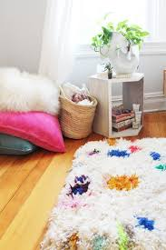 if you have a lot of s yarn laying around you might consider making one of these gorgeous colorful diy rugs you ll need rug canvas