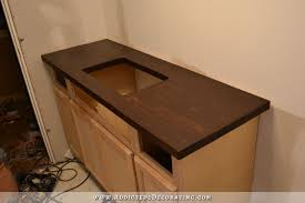 diy butcherblock style countertop for undermount sink finished with dark wood stain