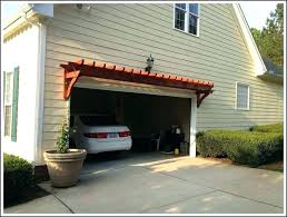 arbor over garage door s vinyl trellis craftsman style stone doors ann mi