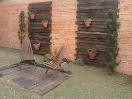cover brick wall with wood.  Cover Vertical Garden Pallet Wooden Slats Varnished Armchairs Flower Pots Bricks  Wall Backyard Lawn In Cover Brick Wall With Wood M