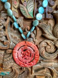 ite with carved jade pendant
