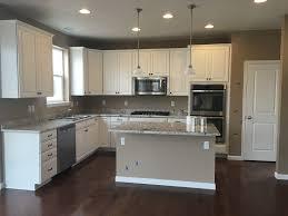 White Kitchen With Hardwood Floors Timberlake Rushmore Linen Cabinets White Galaxy Granite Ctop