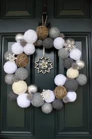 Warm and cozy snowball wreath made from yarn for front door decoration.  Winter and Christmas wreath. Wrap yarn around styrofoam or balls of  newsprint.