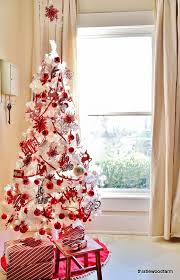 All white tree with all red decorations