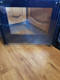 same oven door after the treatment with r r solid cleaning