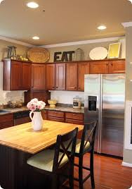 best tips to decorate above kitchen cabinets decorating tops of i22 kitchen