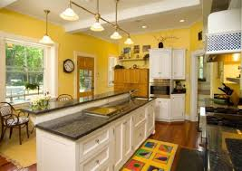 wall colors for white kitchen cabinets black countertops with yellow wall color and glass windows