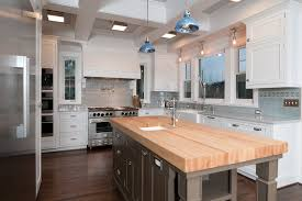 butcher block island for traditional kitchen with white cabinets