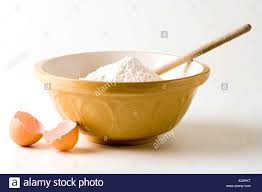 magnificent mixing bowl flour and wooden spoon broken egg stock photo target apkt full size