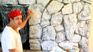 how to paint update an old stone or brick fireplace or wall you