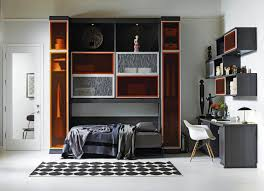 this photo provided by california closets shows a multifunctional horizontal wall bed and home office combination the piece allows guests to feel