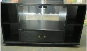 tv cabinet in black wood with glass doors and drawer