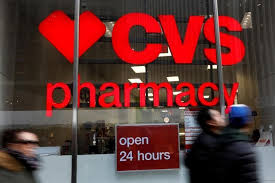 file photo people walk by a cvs pharmacy in the manhattan borough of new