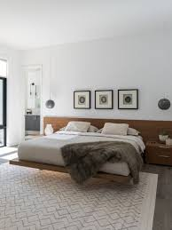 Example of a trendy master medium tone wood floor bedroom design in Dallas  with white walls