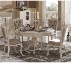 french country round dining table with candle and white classic furniture design