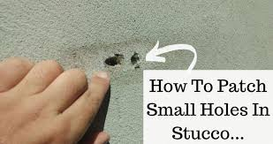 small hole in an exterior stucco wall