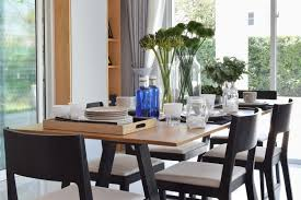 beautiful wooden dining table with modern comfortable chairs in a home elegant settings rooms e10 home