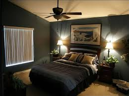 snazzy dark grey wall painted with grey comforter as cover queen size bed also double bedside table lamps as well as ceiling fan in vintage grey small