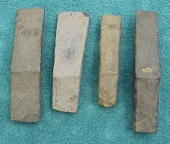 hawaiian adze. a collection of four hafted hawaiian adze the longest being 10.\ h
