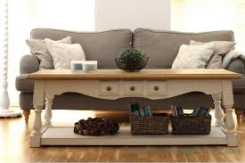 front view of the coffee table makever with the brown sofa behind