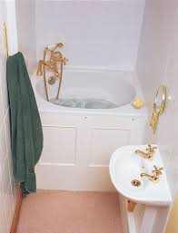 small bathroom idea with corner deep tub with gold-tone faucet stand-basin  for