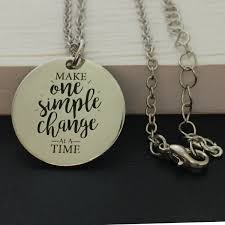 make one simple change at a time silver pendant necklace