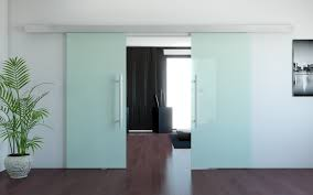 double frosted glass door with stainless steel handle for large modern apartment design with floating vinyl floor tiles painted with brown color ideas